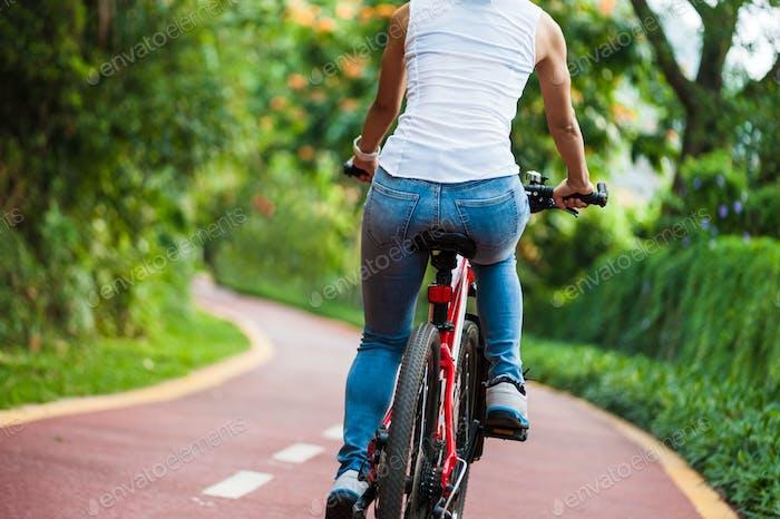 CyclingWoman cyclist riding mountain bike in park