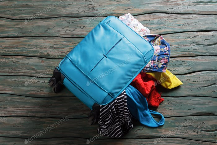 Luggage bag filled with clothes