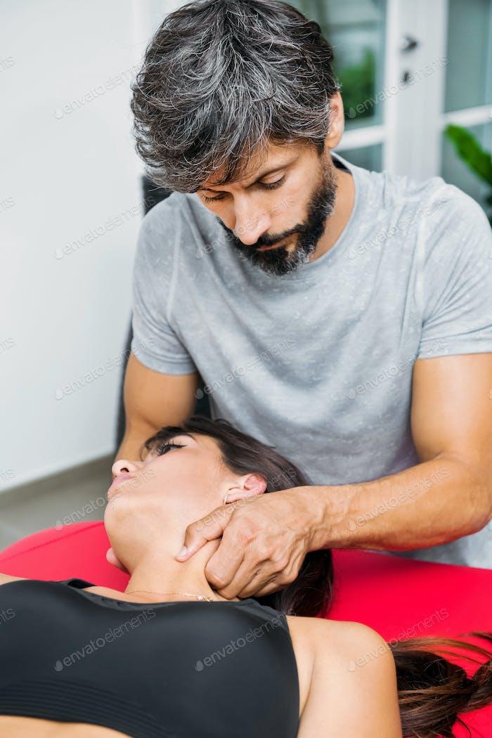 Osteopath performing sternocleidomastoid massage