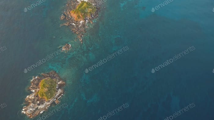 Top down of rock isles at ocean bay aerial. Nobody nature seascape of sea gulf. Green tropic plants