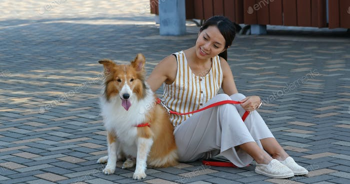 Woman go out with Scotch Collie