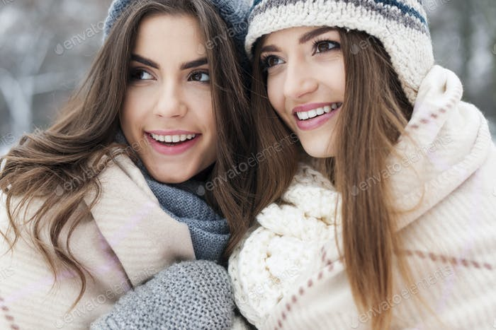 Close up of female friends during the winter
