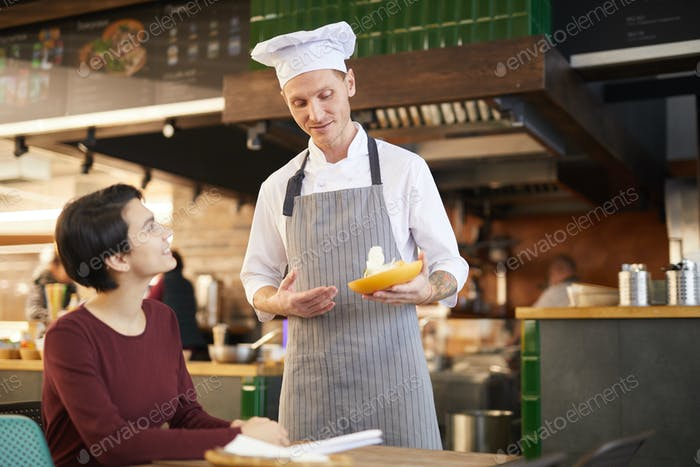 Restaurant Chef Talking to Guest