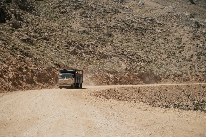 Truck driving on mountain road
