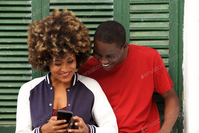 happy young couple together with mobile phone