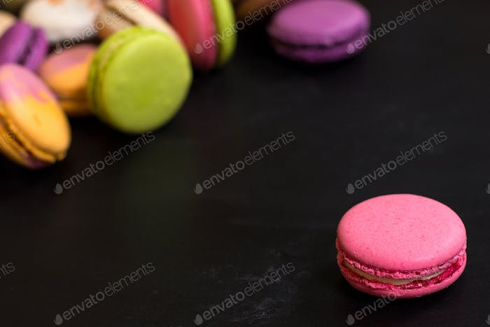 Colorful macaroons on a dark background