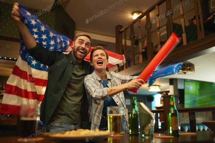 American couple in sport bar