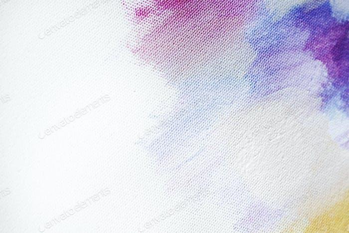 Pincelada colorida sobre un fondo de lienzo