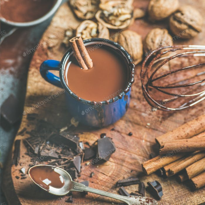 Making rich hot chocolate with cinnamon and walnuts, square crop