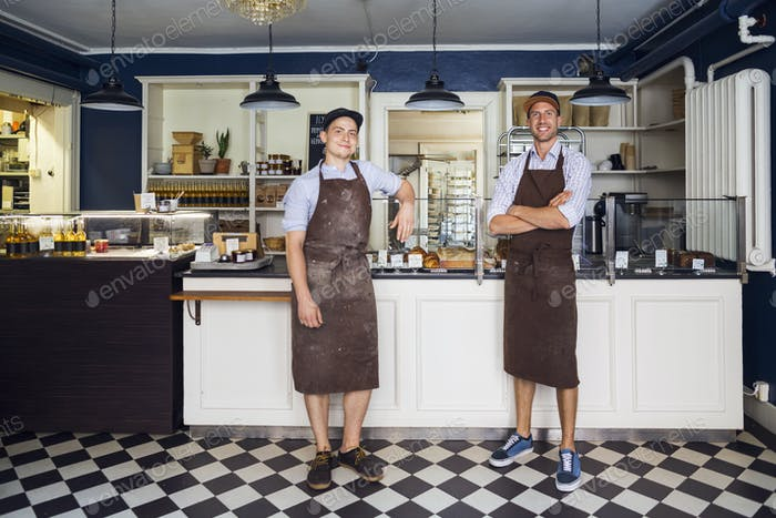 Portrait of young owners in bakery