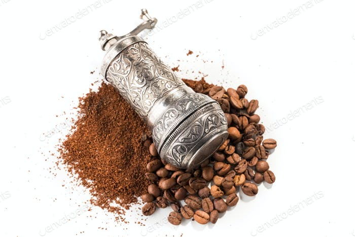 Coffee and grinder on white background