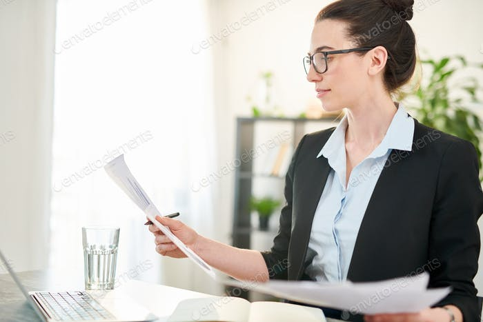 Successful Businesswoman Reading Documents