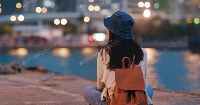Woman enjoy the sea view in the evening