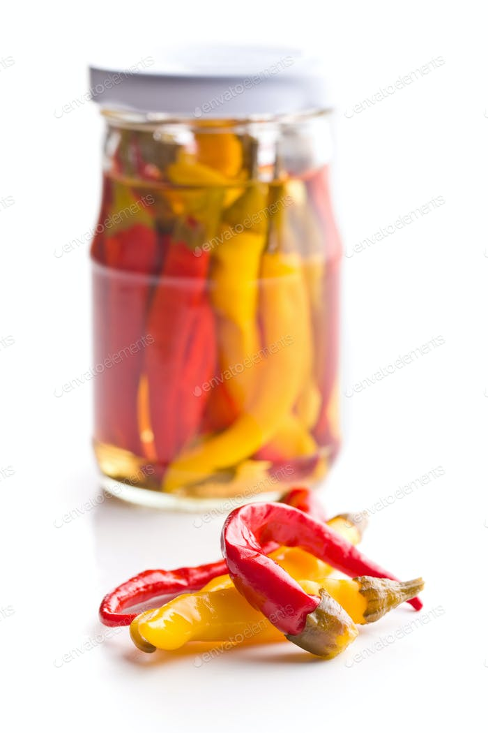 Pickled hot chili peppers. Marinated vegetable.