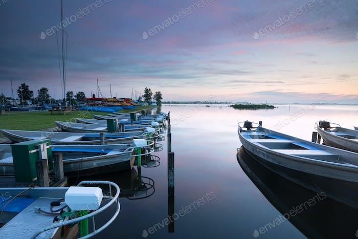 serene dusk over harbor on big lake
