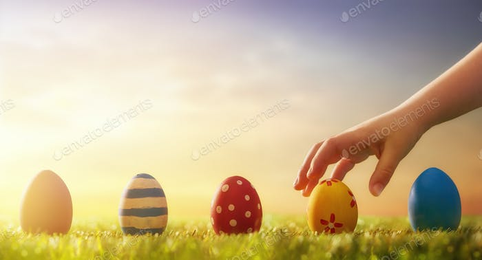 child hunts for Easter eggs