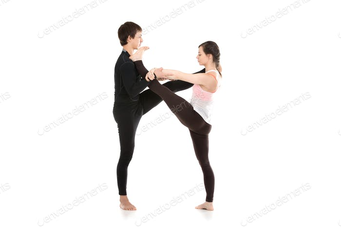 Acro yoga extended hand-to-big-toe pose