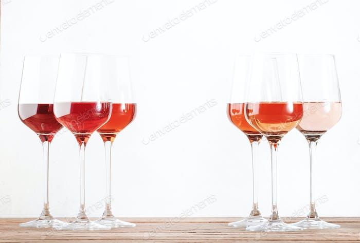 Rose wine glasses set on wine tasting. Tasting different varieties, colors and shades