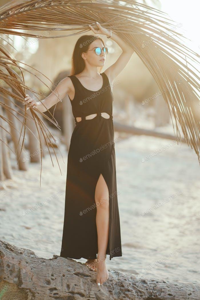 brunette girl exploring the beach