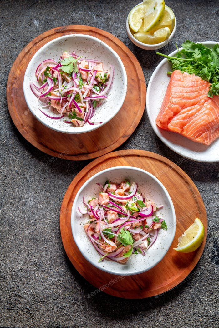 Chilean salmon ceviche. Fresh raw salmon marinaded with purple onion, coriander in lemon juice.