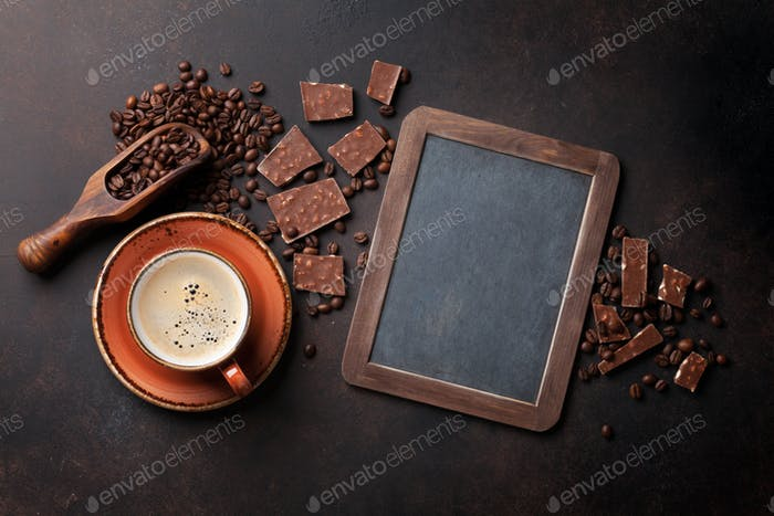Coffee cup and chocolate on old kitchen table