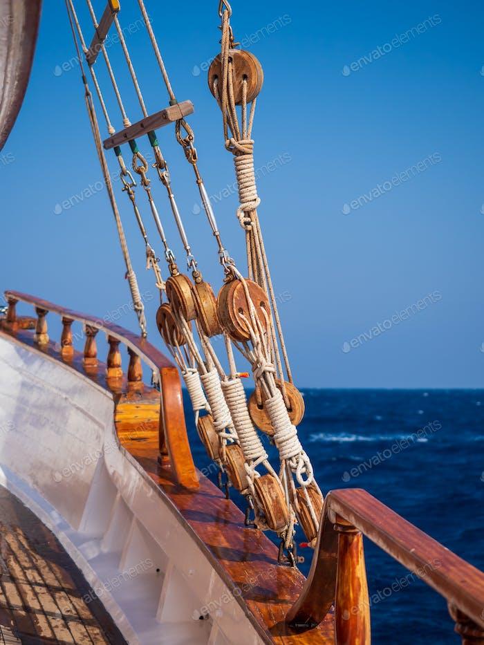 Old ship tackles. Old sailing ship vessel.