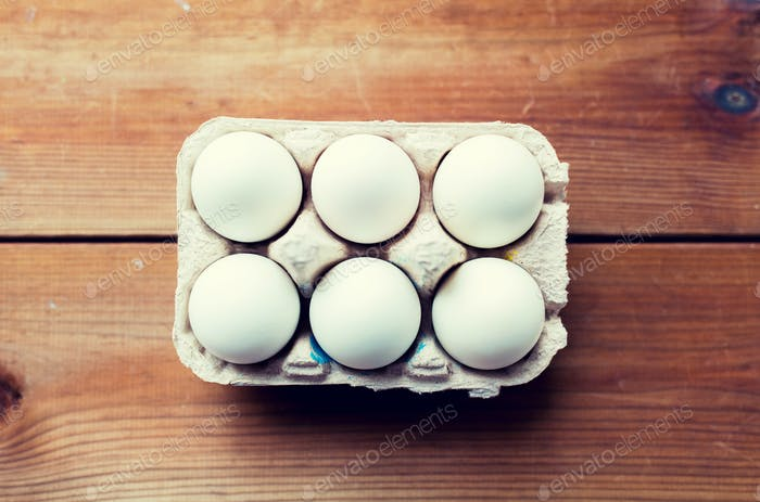 close up of white eggs in egg box or carton