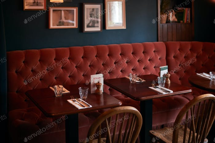 Interior Of Traditional English Pub With Table Set For Meal