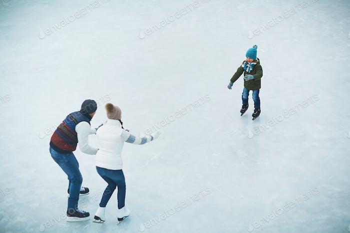 Family on skating rink