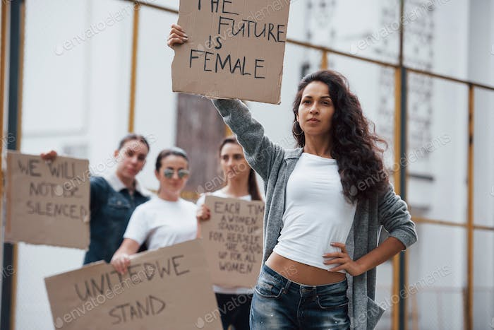 Hispanic ethnicity. Group of feminist women have protest for their rights outdoors