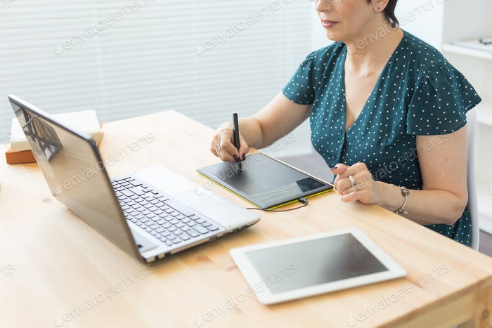 Illustrator, web designer and artist concept - Graphic designer using her pen tablet in a bright