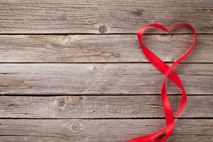 Valentines day greeting card and heart shaped ribbon