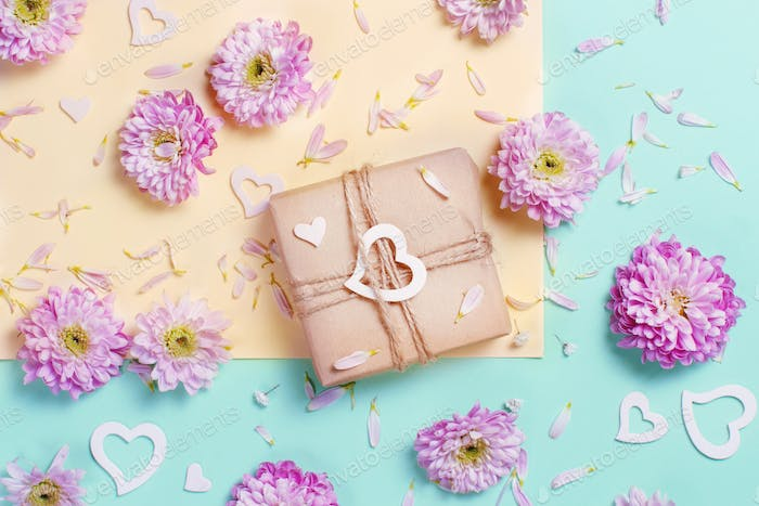 Flowers composition with hearts and gift box