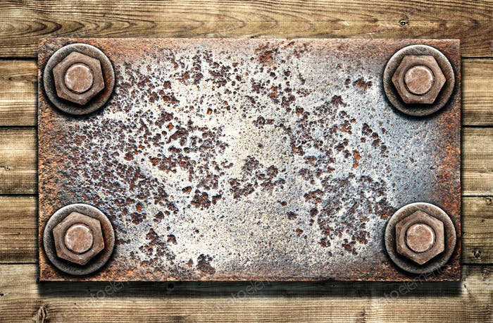 Old metal plate on  wooden wall