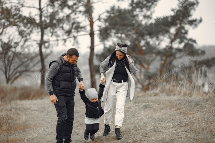 Cute family playing in a spring forest