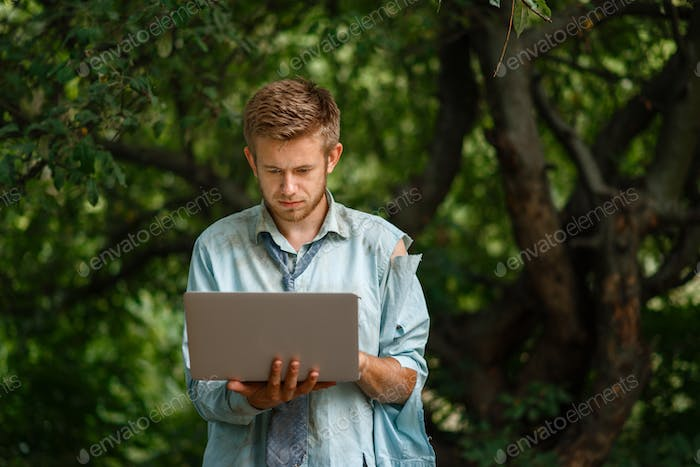 Alone businessman with laptop on desert island