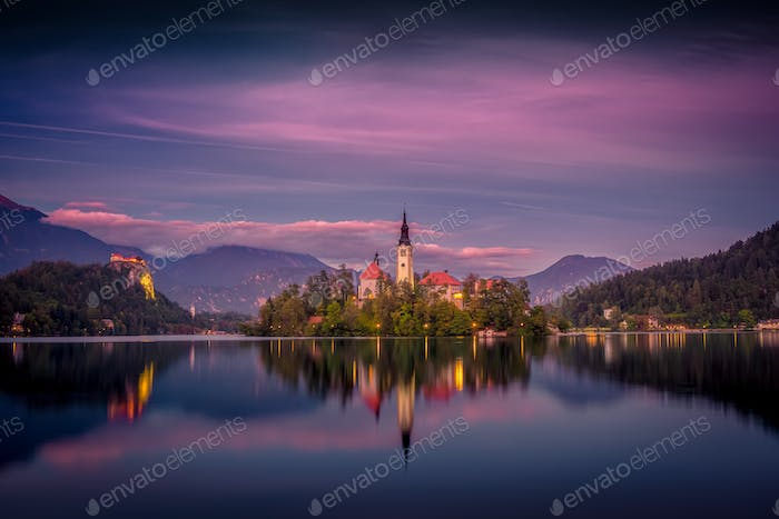 Colorful sunset landscape view of Lake Bled island and church, Slovenia