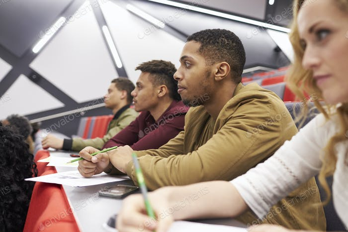 Students listening to lecture at university lecture theatre