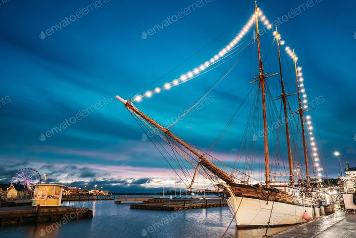 Helsinki, Finland. Old Wooden Sailing Vessel Ship Schooner Is Moored To The City Pier, Jetty
