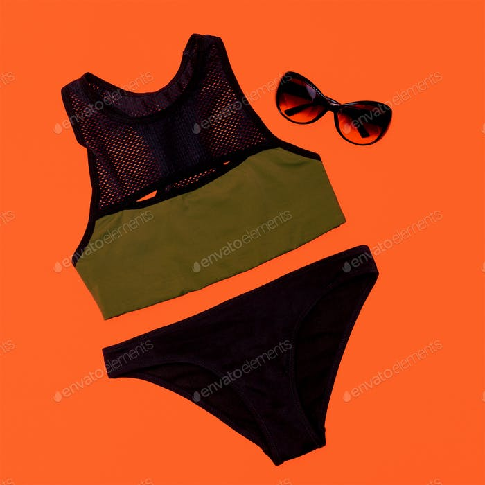 Stylish sports swimsuit. Summer outfit