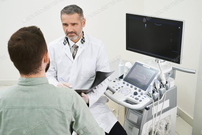 Doctor and patient consultation in medical cabinet
