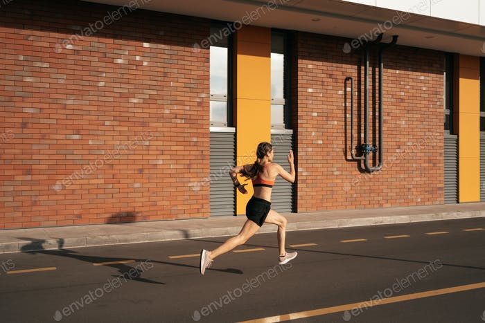Women sprinting in the morning outdoors.