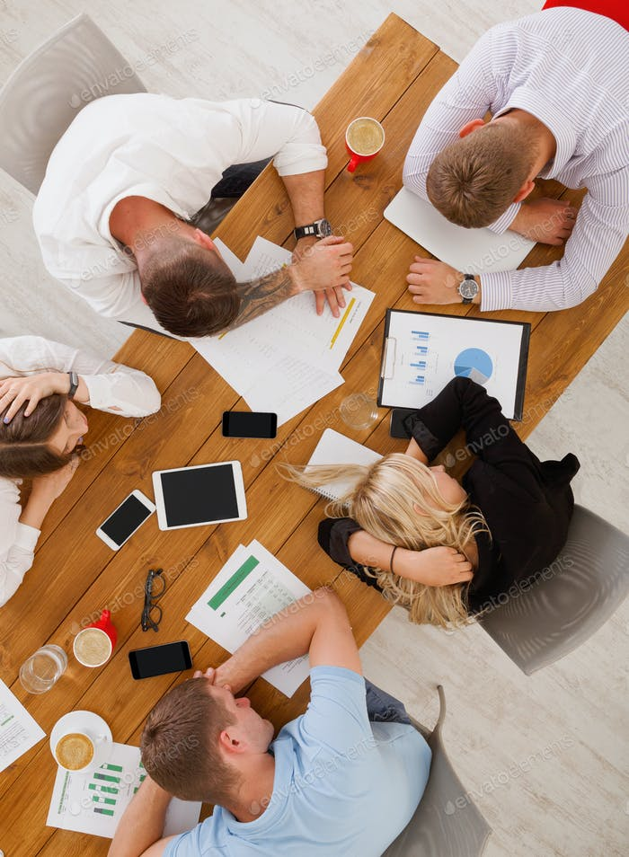 Group of business people exhausted sleep in office, top view