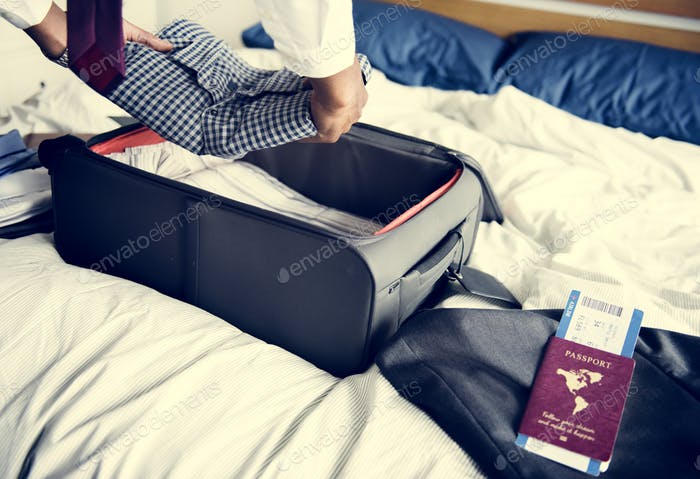 A man preparing his suitcase for travel