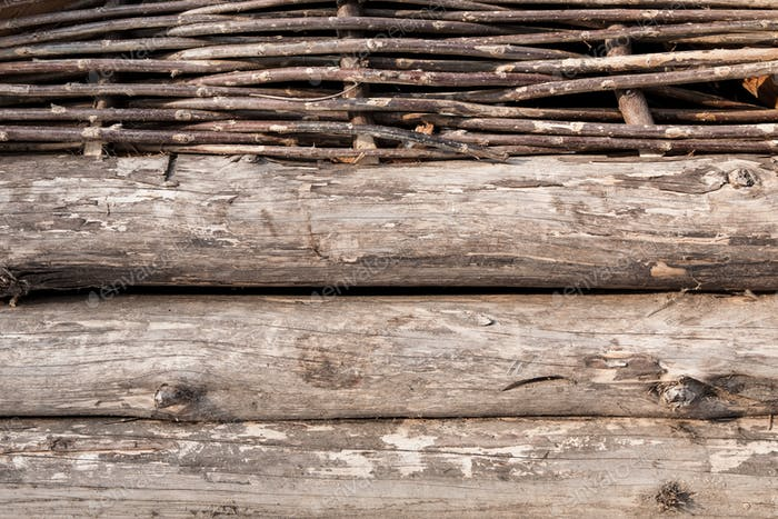 Wooden logs and wattle wall