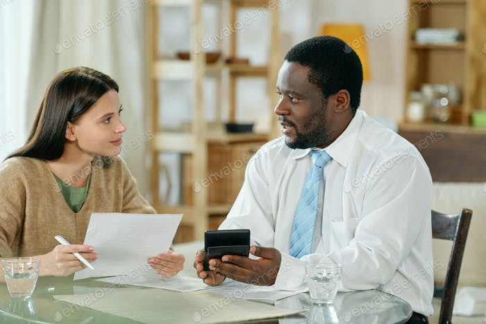 Diverse man and woman consulting on loan