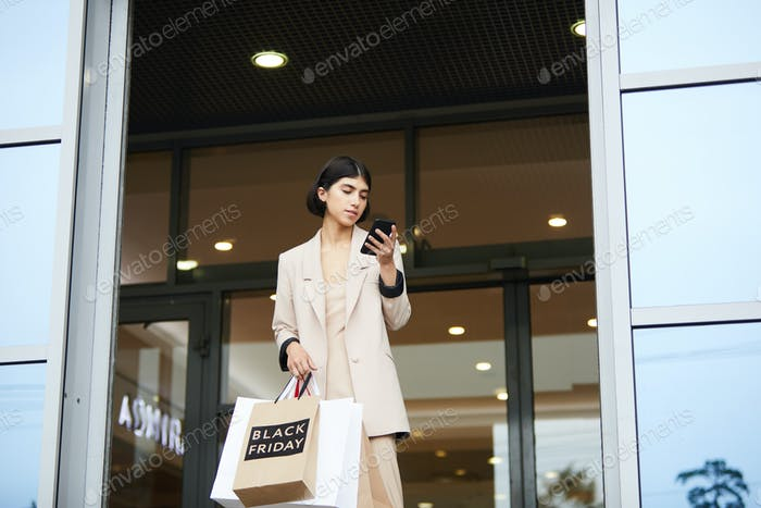 Young Woman Leaving Boutique