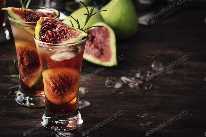 Red cocktail with cognac, liquor, lime juice, figs and honey