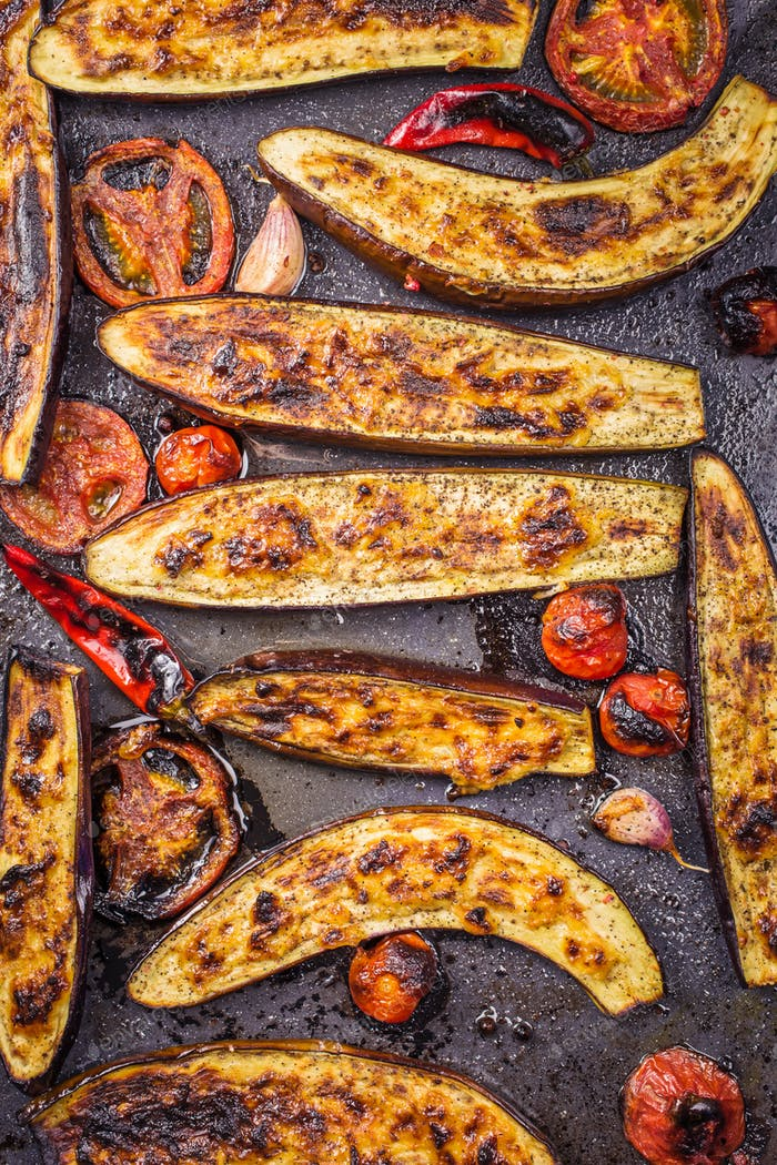 Roasted eggplants on baking tray top