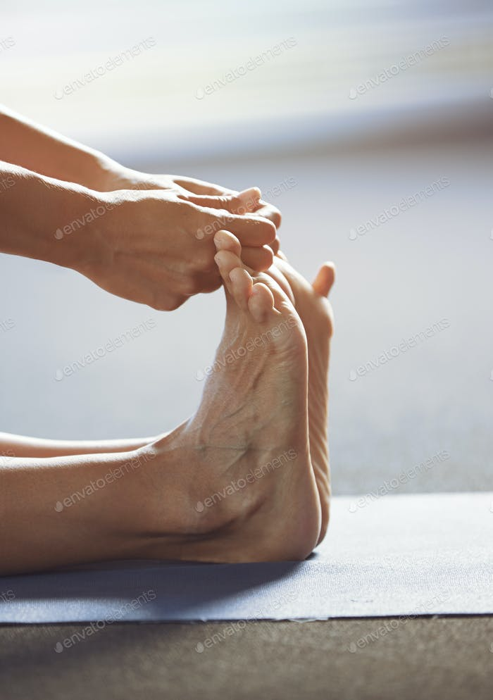 Close-up of the man doing yoga stretching exercise